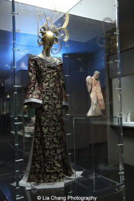 Gallery View Chinese Galleries, Charlotte C. Weber Galleries, Ancient China- House of Givenchy (French, founded 1952), Alexander McQueen (British, 1969–2010), Ensemble, autumn/winter 1997-haute couture Dress of red-purple and gold silk brocade; jumpsuit of gray silk crêpe de chine and gray cockerel feathers, Purchase, Friends of the Costume Institute Gifts, 2013, (2013.564a,b); Chinese Female Dancer, Western Han dynasty (206 B.C.–A.D. 9), 2nd century B.C., Earthenware with pigment, Charlotte C. and John C. Weber Collection, Gift of Charlotte C. and John C. Weber, 1992 (1992.165.19). Photo by Lia Chang