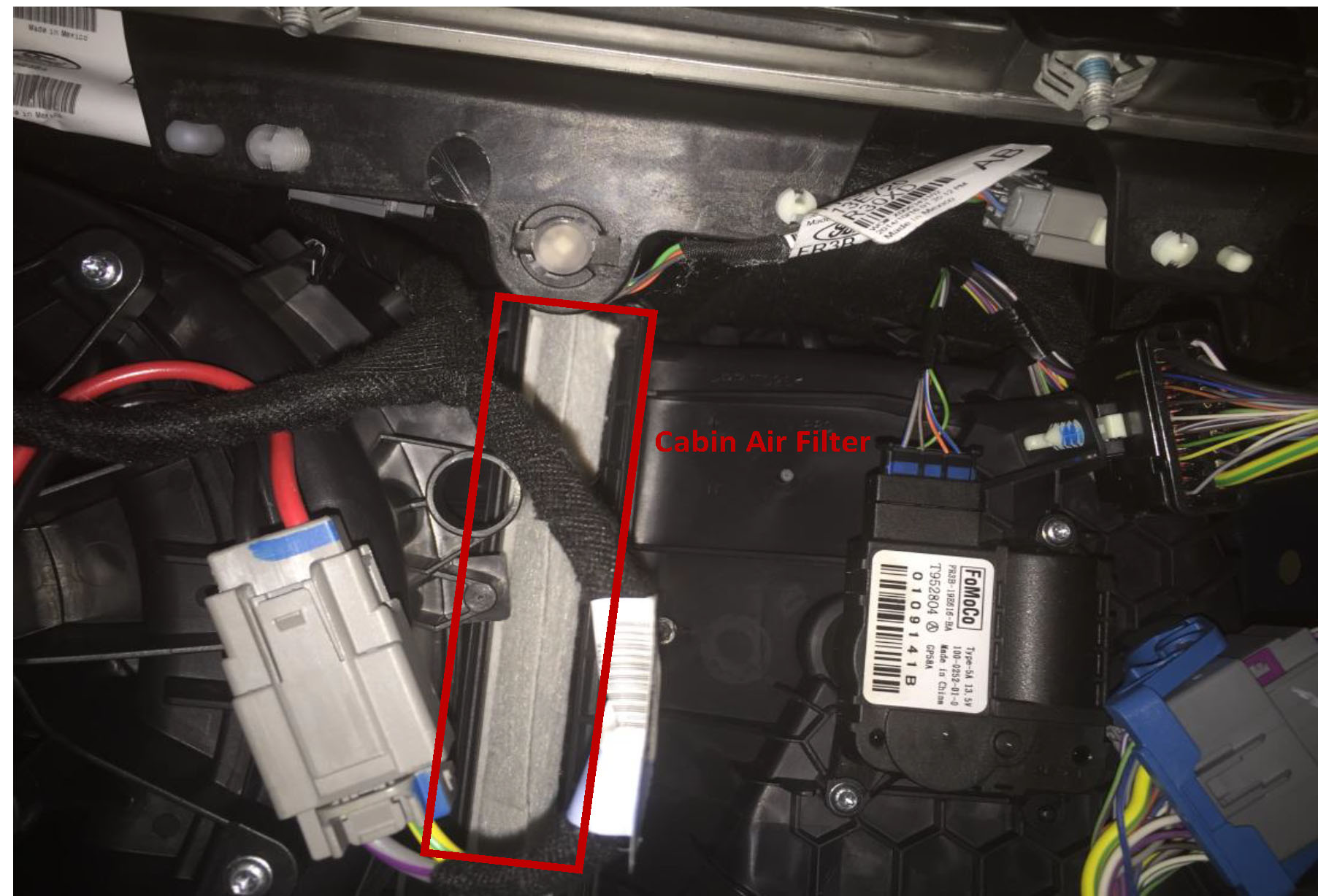 hight resolution of partially remove the old air filter by grasping the tab on the bottom and gently pulling