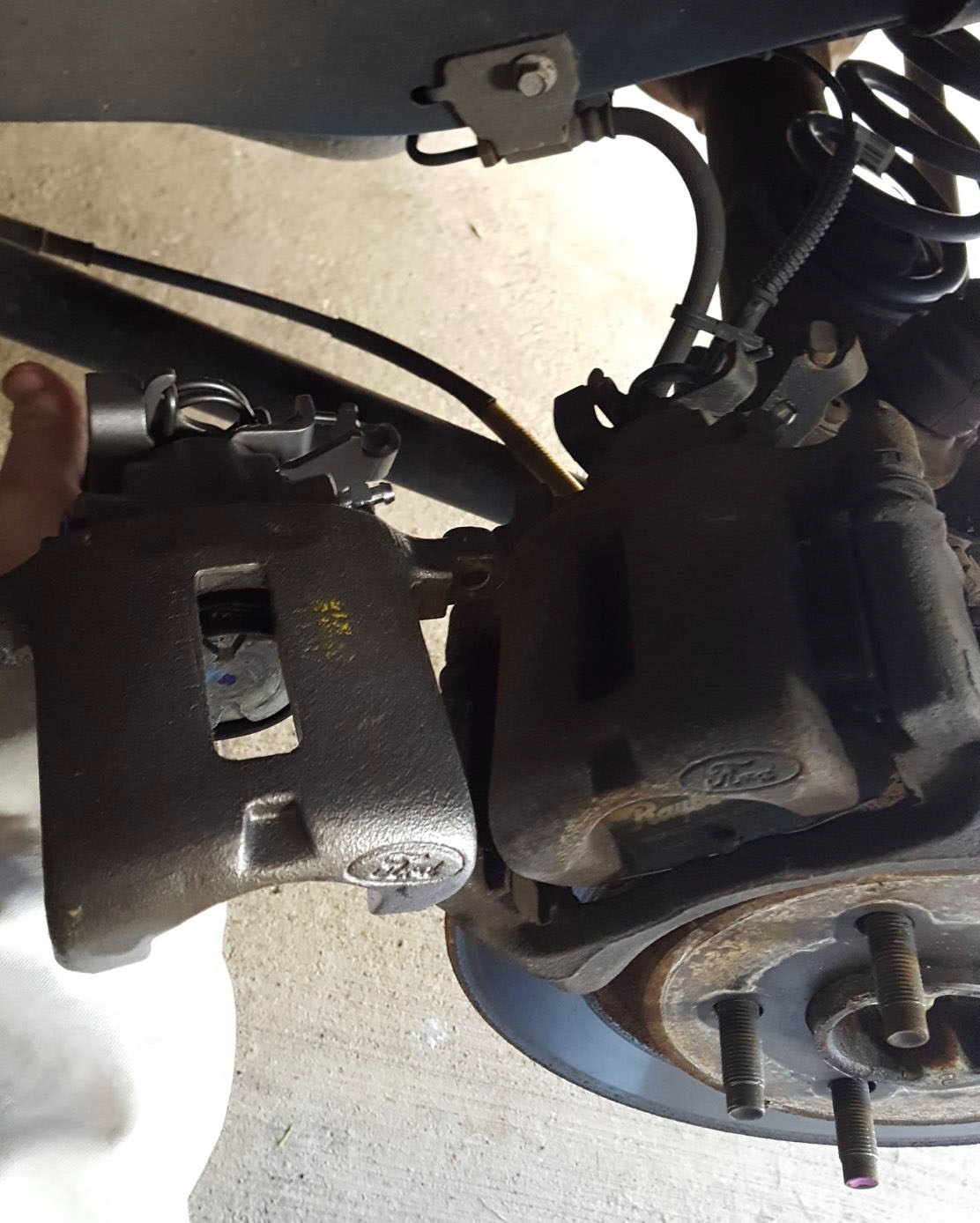 hight resolution of 4 use a 13mm socket and wrench to remove the 2 bolts holding the brake caliper bracket one bolt is on top and other bolt is on the bottom