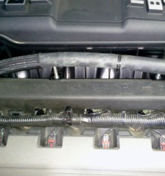 plug in all fuel injector electrical connectors then connect the fuel feed line to the fuel rails reinstall the foam sound deadeners around the fuel rails  [ 1211 x 892 Pixel ]