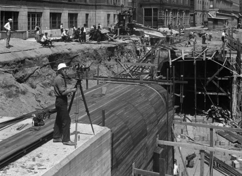 Photo of Surveyor showing bystanders