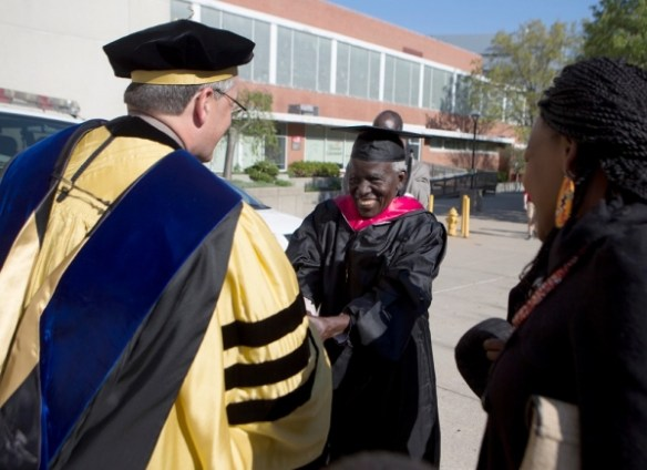 UC Graduate Samuel Ochiel Obura is greeting on campus by Richard Harknett, head of UC's political science department, 48 years after Mr. Obura finished his degree requirements.  photos/Joseph Fuqua II.
