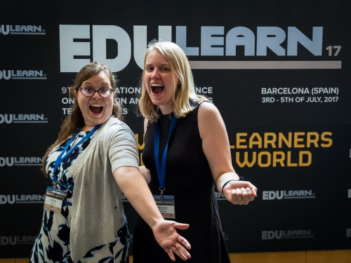 Kellie and Becky posing in front of the EduLearn sign.