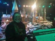 Kellie in front of a model of Hogwarts