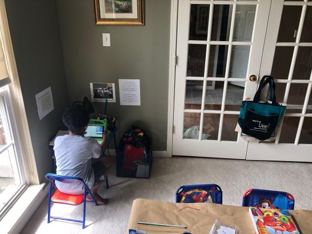 Boy sitting at desk.