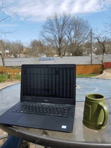 laptop on outdoor patio table