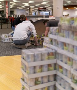 students constructing canned sculpture