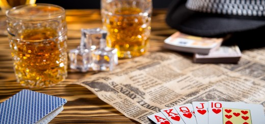 Cards and whiskey for article on promotional games of skill and sweepstakes for alcohol producers