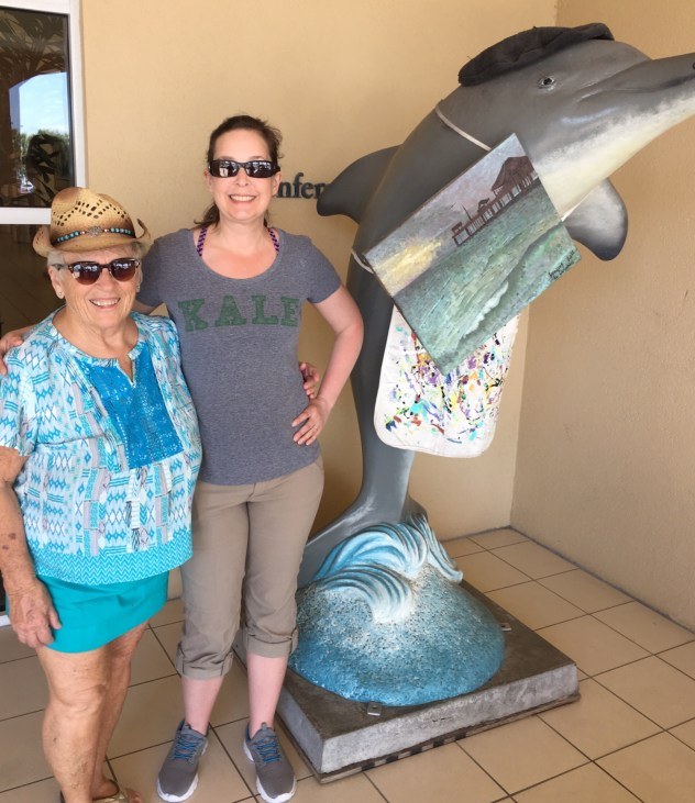 Whitehawk and Libby with an artist dolphin