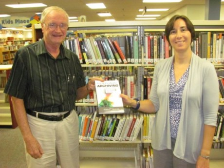 Presentation of my book to Cherilyn Fiory, Director of the Upper Dublin PA Public Library (Photo by Lauren Smyth, Assistant Director)