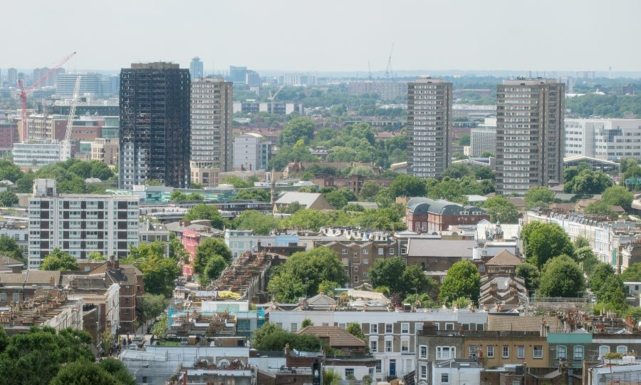 An aerial view of the Grenfell Tower, after the fire, showing the surrounding area to the extent of the other three nearby tower blocks.