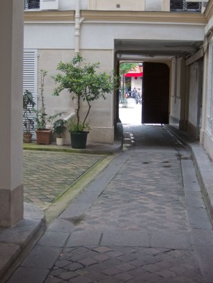 This is the typical appearance of a path for the carriage. See the ruts on both sides? That is for the wheels. There is a larger courtyard behind me where they would turn around.
