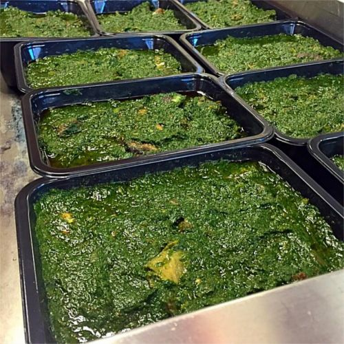 Sweet Potato Greens being packaged for delivery