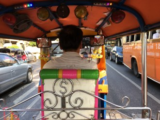 Tuk-tuk traveling in Bangkok