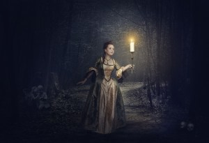 Beautiful Woman With Candle In Medieval Dress On The Foggy Road