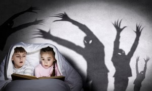 children reading in bed with ghostly silhouettes