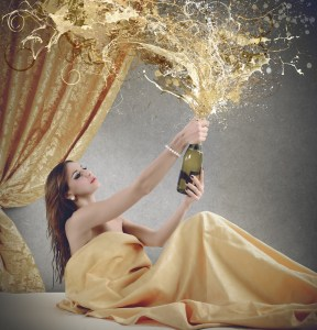 woman in bed uncorks exploding champagne, metaphor for explicit sex