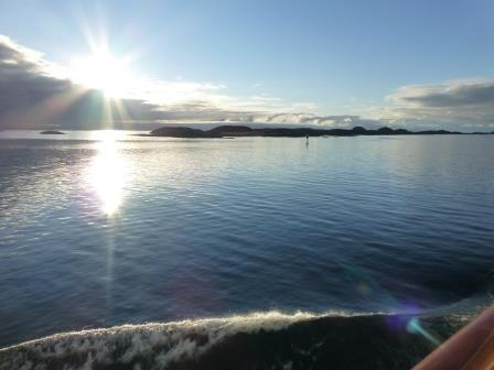 calm water of Norwegian fjord as sun goes down