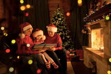 Christmas with family reading in front of glowing fire