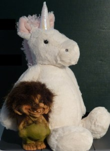 White and pink unicorn toy with Olaf the Troll