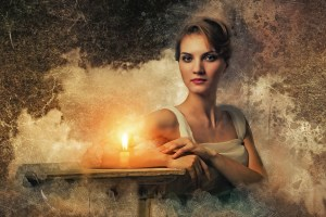 writer in mist with candle