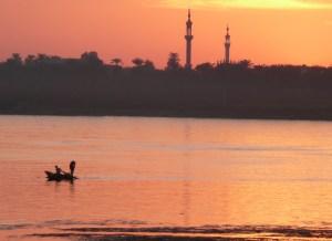 sunset, fisherman at Aswan on Nile
