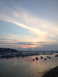 marina with yachts at sunset, where book location began