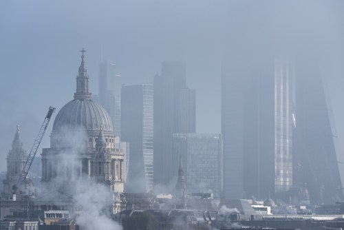 London skyline with St Paul's dome and skyscrapers in fog