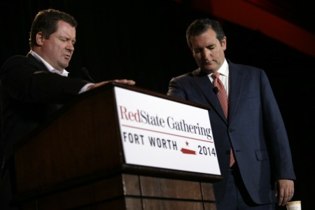 Erickson praying with Cruz. Credit: AP Photo/Tony Gutierrez.