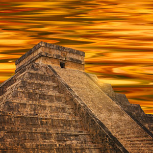 An aztec temple against a murky orange sky