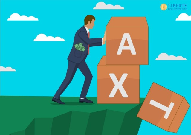 Man pushing large toy blocks that spell tax off a cliff with money in his pocket show that real estate investing can provide more cash flow and income with less taxes