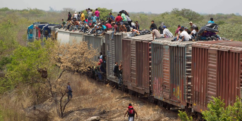 "FILE - In this April 29, 2013 file photo, migrants ride on top of a northern bound train toward the US-Mexico border in Union Hidalgo in Oaxaca, Mexico. Al Jazeera America will air a series titled ""Borderland"" which takes average Americans with strong opinions about illegal immigration through the same deadly journey that is taken by people trying to reach the U.S. The series premieres on April 13, 2014. (AP Photo/Eduardo Verdugo, File)"