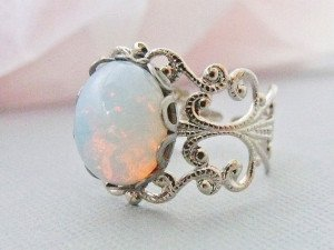 Opal ring set in white gold with diamonds on the sides