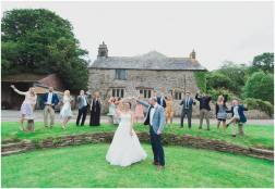 wedding photographer in Cornwall Pengenna Manor group photo dancing