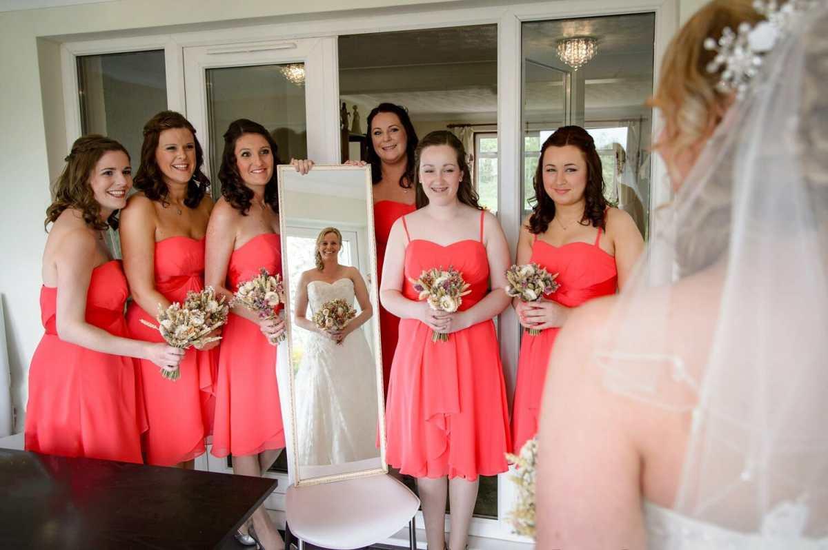 bride-looks-in-mirror