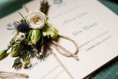 Stunning buttonhole on Larmer Tree Garden Wedding stationery