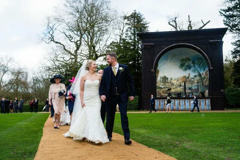 Bride and groom in the gardens at Larmertree Gardens, Wiltshire