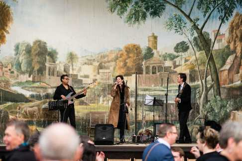 Band on stage at the Larmer tree gardens Wiltshire wedding