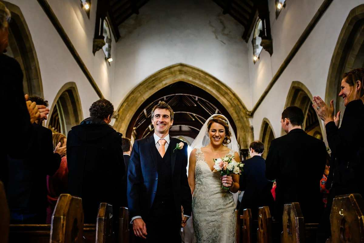 Bride and Groom walk out of St Edwards