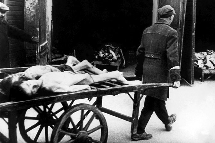 A man carries away the bodies of dead Jews in the Ghetto of Warsaw in 1943, where people began to die of hunger in the streets. Every morning, about 4-5 a.M., funeral carts collected a dozen or more corpses on the streets. The bodies of the dead Jews were cremated in deep pits. In November 1940, the Germans established the Warsaw ghetto. The Jewish population still living outside was brought inside the special area, and the Polish living within the designated ghetto boundaries were ordered to move out. On November 15th no Jew was allowed to leave the Jewish precincts. In the Summer of 1942, about 300,000 Jews were deported to Treblinka. When reports of mass murder in the killing center leaked back to the ghetto, a surviving group of mostly young people formed an organisation called Z.O.B. (Zydowska Organizacja Bojowa, Jewish Fighting Organisation) calling for the Jewish people to resist. On April 19, 1943 the Warsaw ghetto uprising began after German troops and police entered the ghetto to deport its surviving inhabitants. Seven hundred and fifty fighters fought for nearly a month. But on May 16, 1943, the revolt ended The Germans had slowly crushed the resistance. Of the more than 56,000 Jews captured, about 7,000 were shot, and the remainder were deported to killing centers or concentration camps. (FILM)  AFP PHOTO