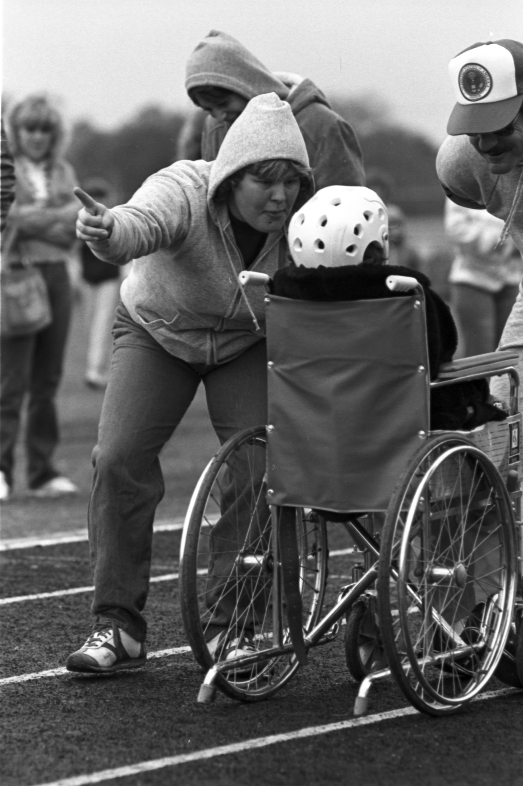 wheelchair olympics peg perego siesta high chair cover a participant gets direction from volunteer along the track during area 11 s special