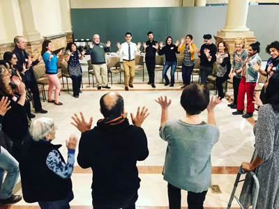 Circle of people engaged in Creative Aging activity.