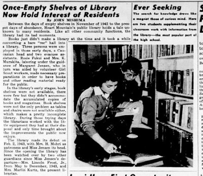 "News clipping, headline ""Once-Empty Shelves of Library Now Hold Interest of Residents. Man and woman by library shelves looking at book."