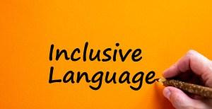 Hand writing 'inclusive language', isolated on orange background.