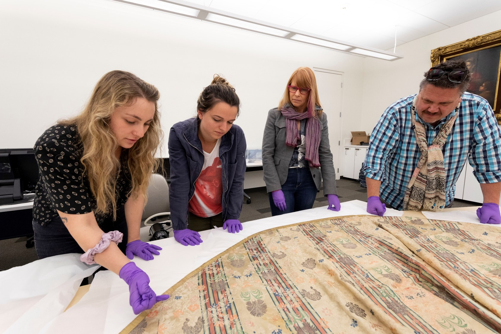 Group of people examining vestment