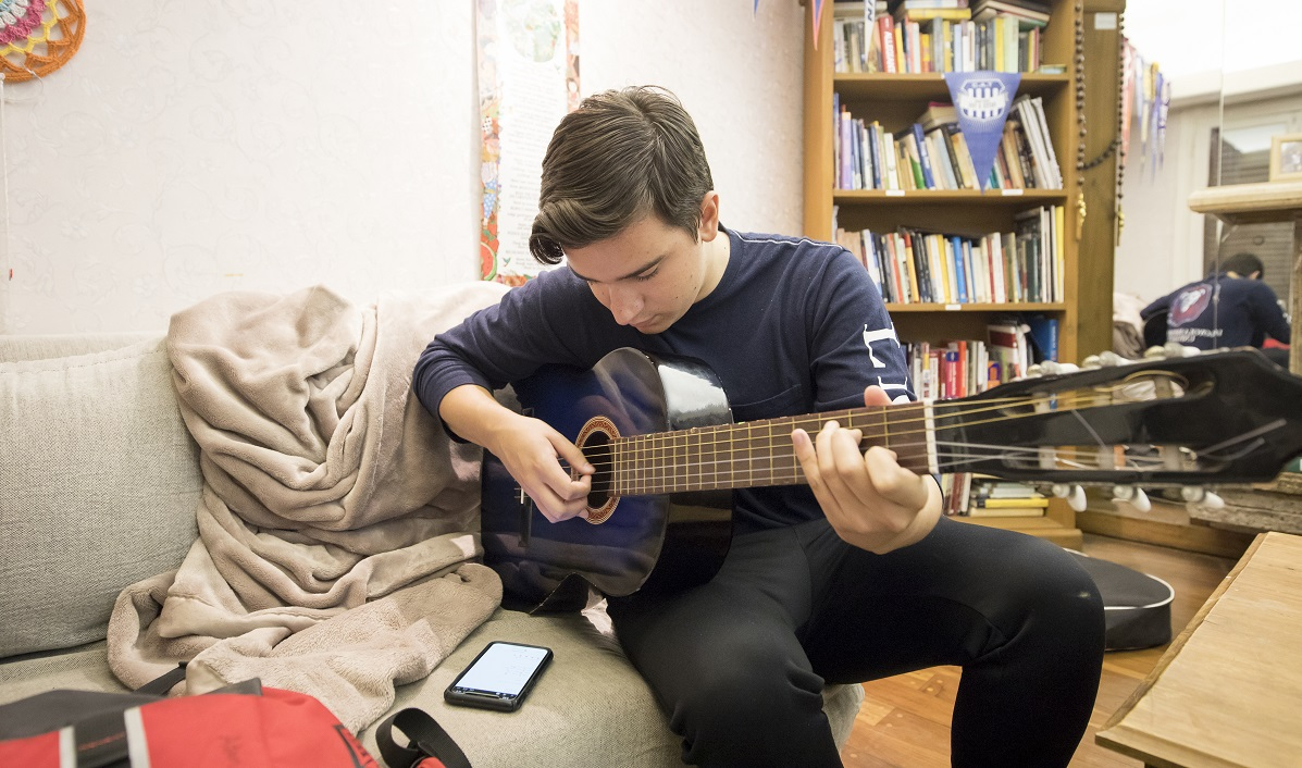 Student playing guitar 2018