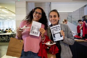 two students holding zines
