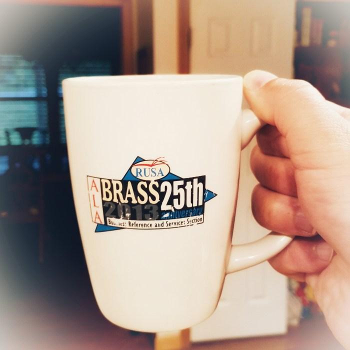 A hand holding a coffee mug