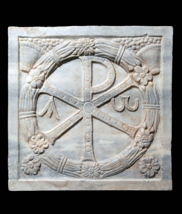 The Christological monogram (X and P, chi-rho), the first two letters of Christ in Greek (ΧΡΙΣΤΟΣ): the symbol instituted by Emperor Constantine I for his military standards (vexillum) and a Christian symbol of eternal life and triumph through Christ. 4th-century CE, marble, Pius-Christian Museum, Vatican City.