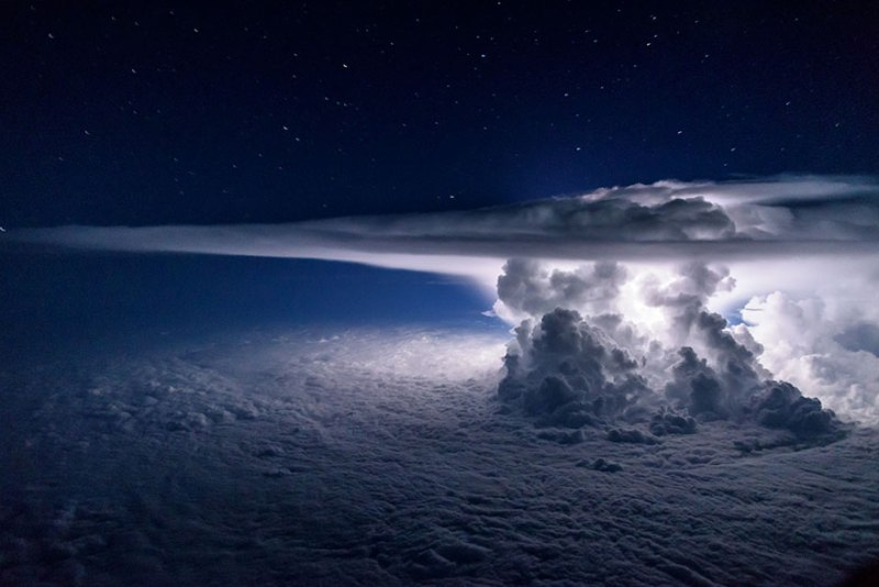 A giant Cumulonimbus cloud with lightning above the Pacific Sea when the polot circulates around 37,000 feet to South America